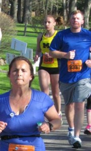 This is the closest I have to a picture of me.  Mile 9 - I'm in the yellow singlet in the background.